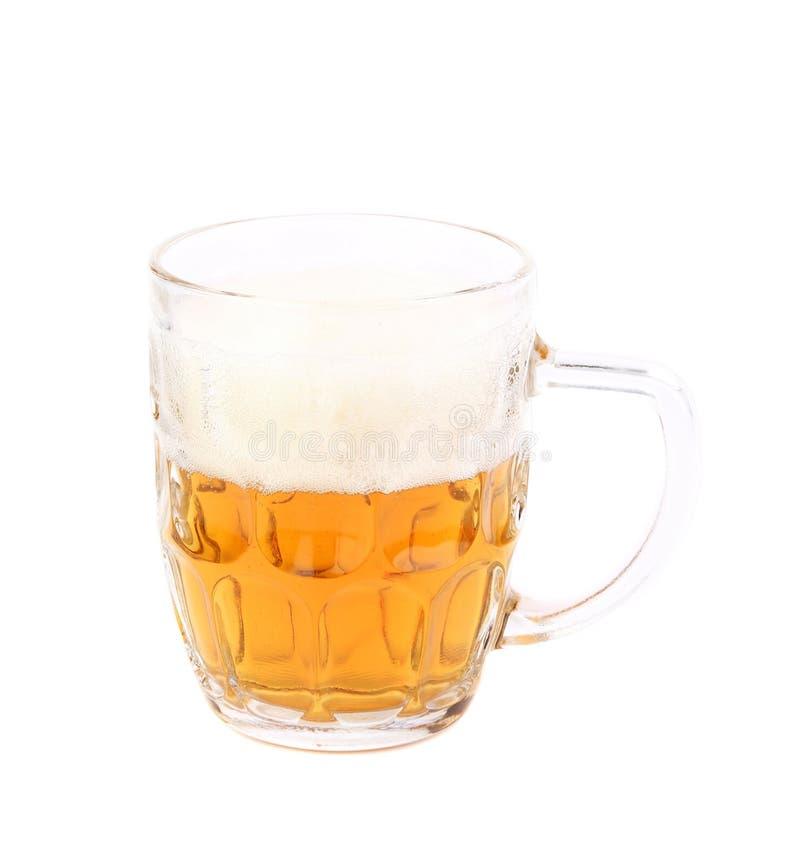 半杯低度黄啤酒 库存照片
