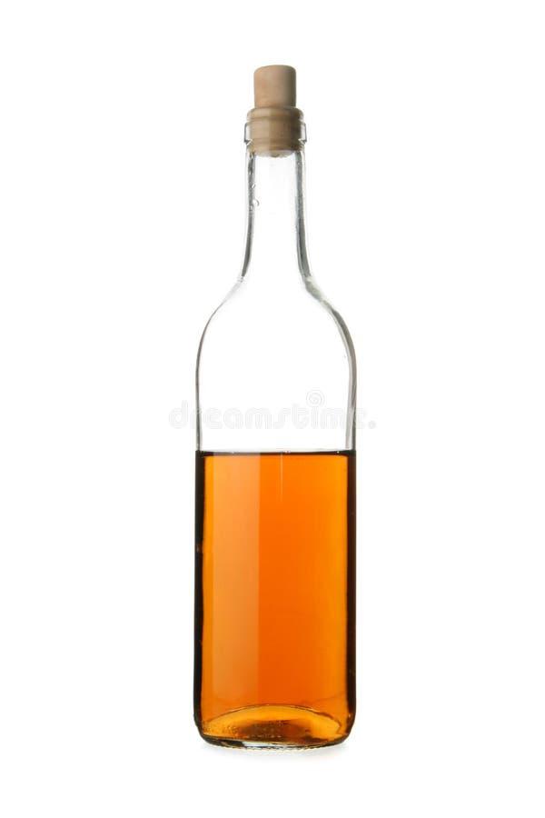 半瓶的白兰地酒 免版税库存图片