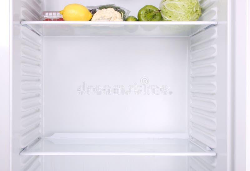 半空的冰箱 免版税库存图片