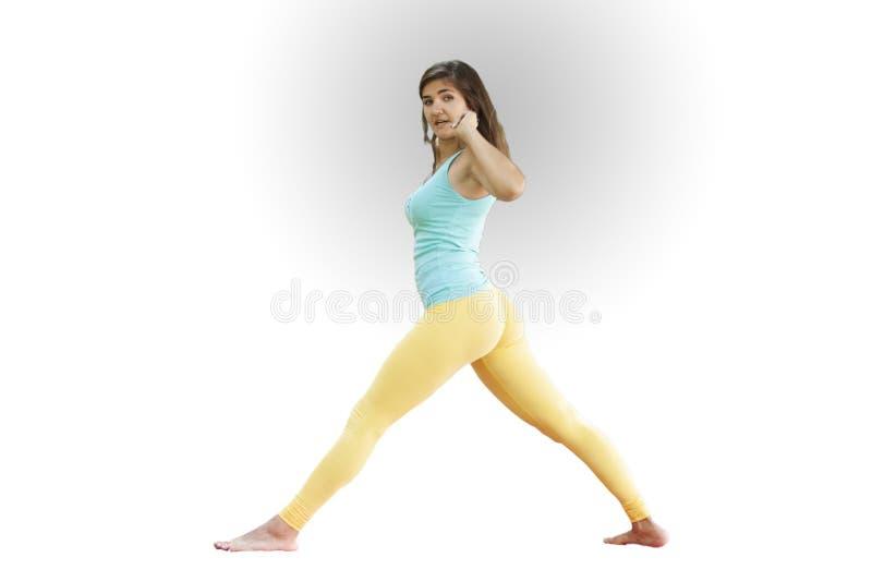 华美的年轻女人实践的瑜伽 平静和放松,女性幸福概念 免版税库存图片