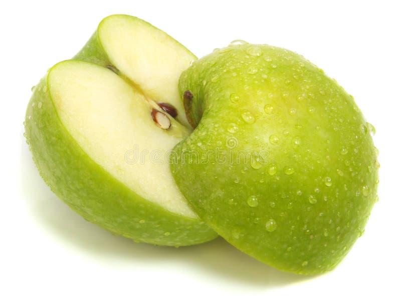 单独的苹果被削减的新绿色 免版税库存图片
