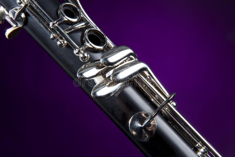 单簧管查出的紫色聚光灯 库存图片
