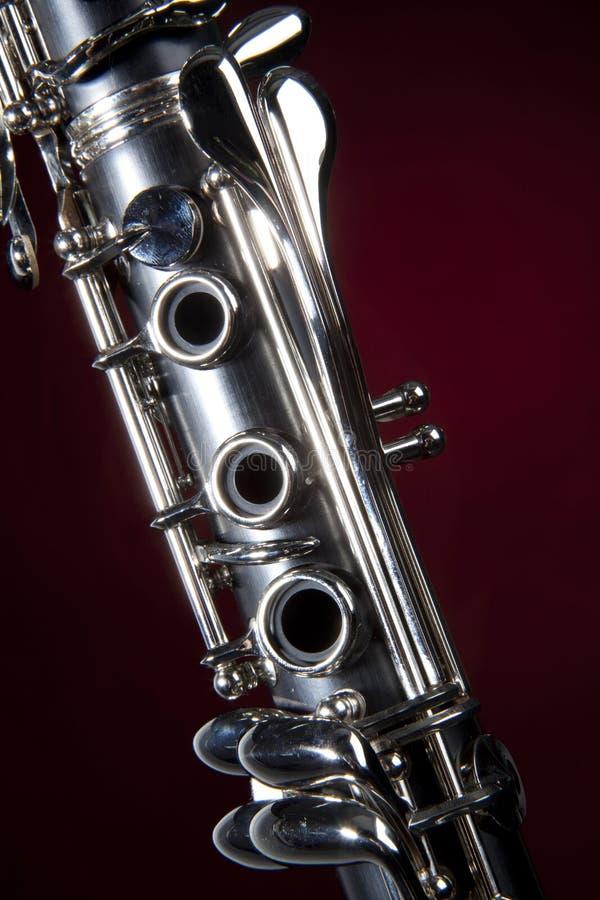 单簧管查出的红色聚光灯 免版税图库摄影