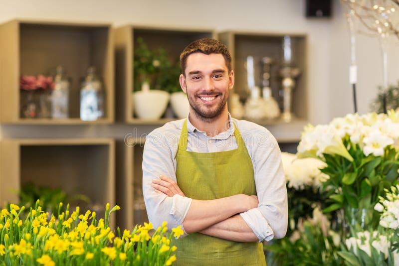 卖花人人或卖主花店柜台的 免版税库存照片
