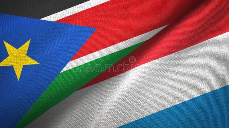 南苏丹和卢森堡两旗子纺织品布料,织品纹理 库存照片