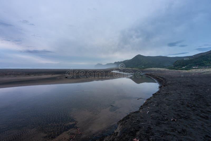 南Piha日落奥克兰西海岸新西兰 库存照片