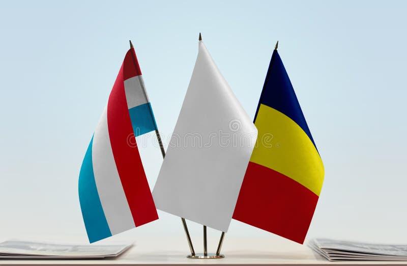 卢森堡和乍得的旗子 免版税库存图片