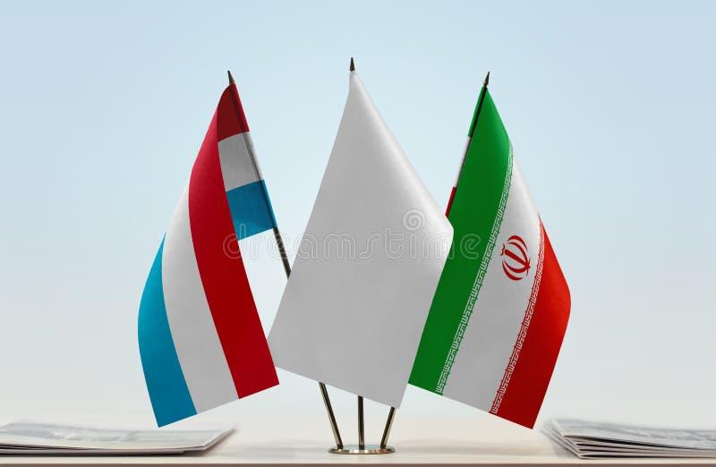 卢森堡和伊朗的旗子 免版税库存照片