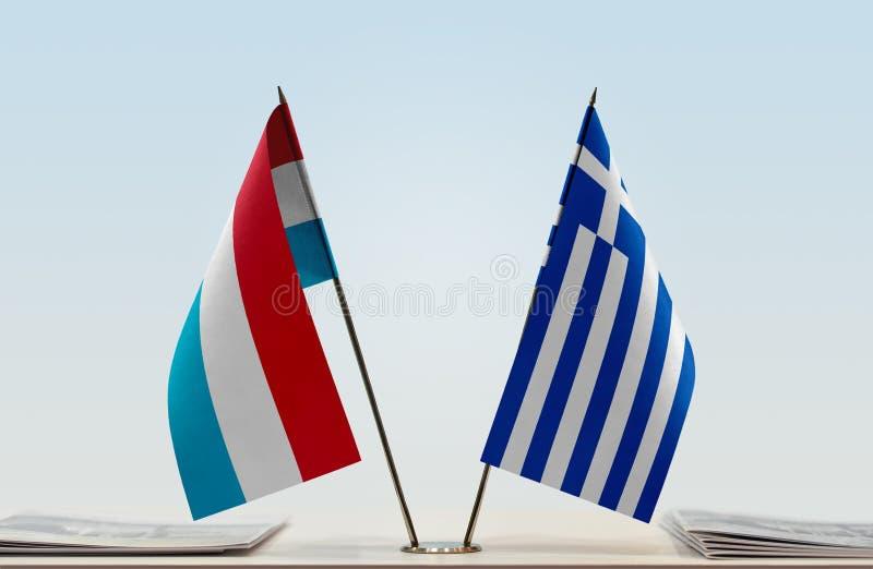 卢森堡和希腊的旗子 免版税库存照片
