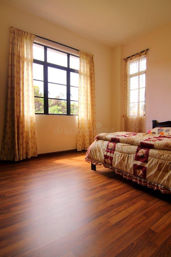 卧室地板硬木 免版税库存照片