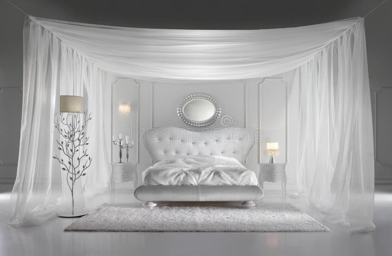 卧室豪华白色 免版税库存照片