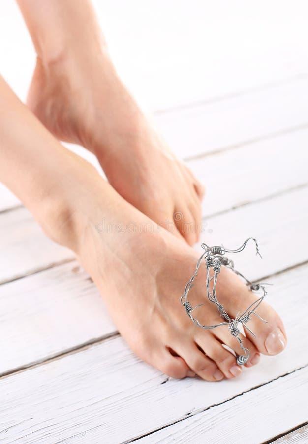 卫生学脚,钉子塑料 免版税库存图片