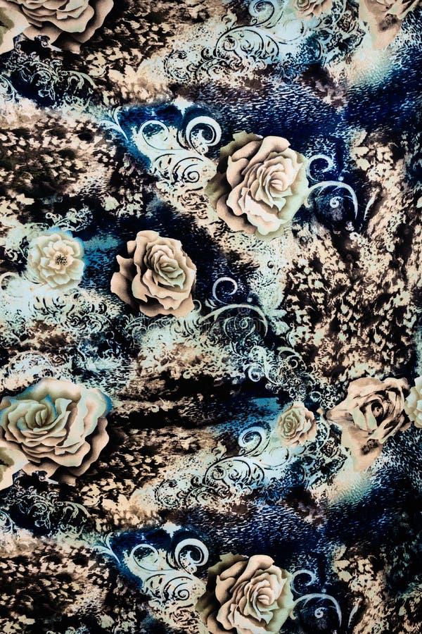 印刷品织品纹理镶边了豹子和花 库存照片