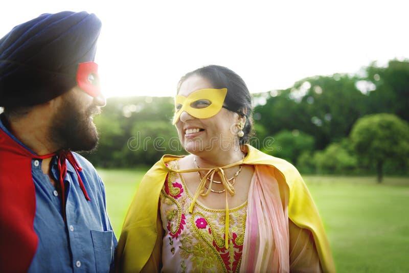 印地安夫妇超级英雄爱概念 图库摄影