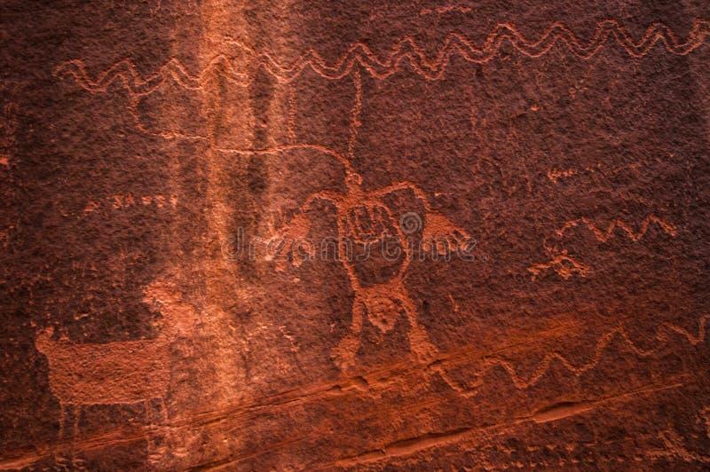 印地安岩石绘画纪念碑谷美国。纹理 免版税库存图片