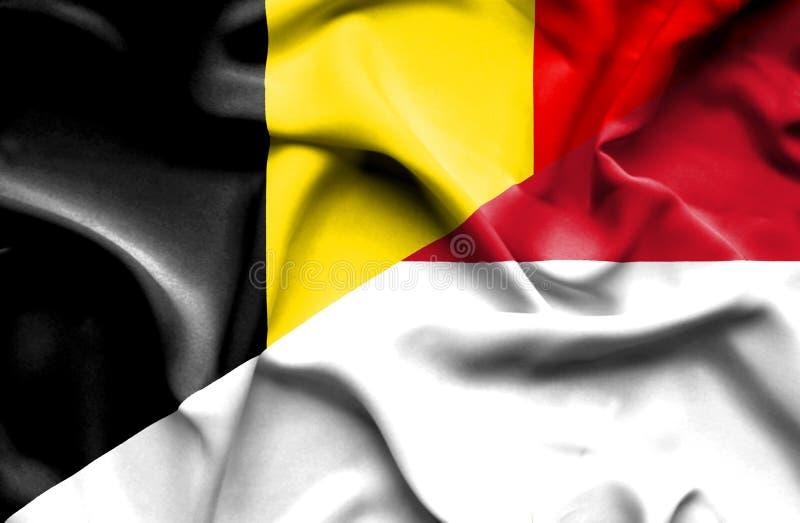 印度尼西亚和比利时的挥动的旗子 向量例证