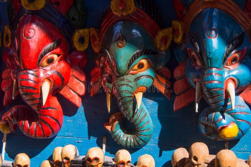 印度神尼泊尔纪念品木面具  免版税库存照片