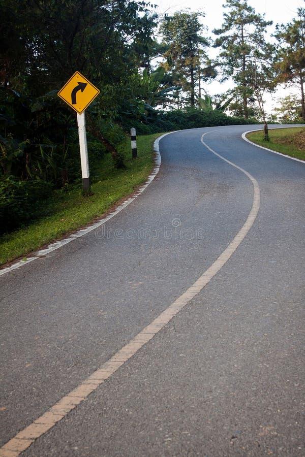 危险曲线标志 库存图片