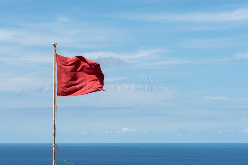 危险红旗 免版税库存图片