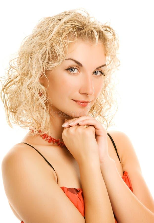卷毛头发妇女 免版税库存照片
