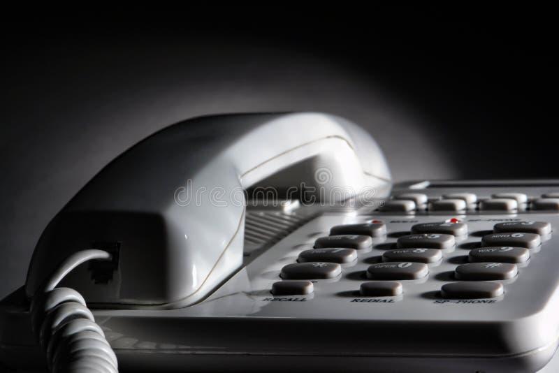 卷起的绳子服务台办公室电话电话白&# 库存图片