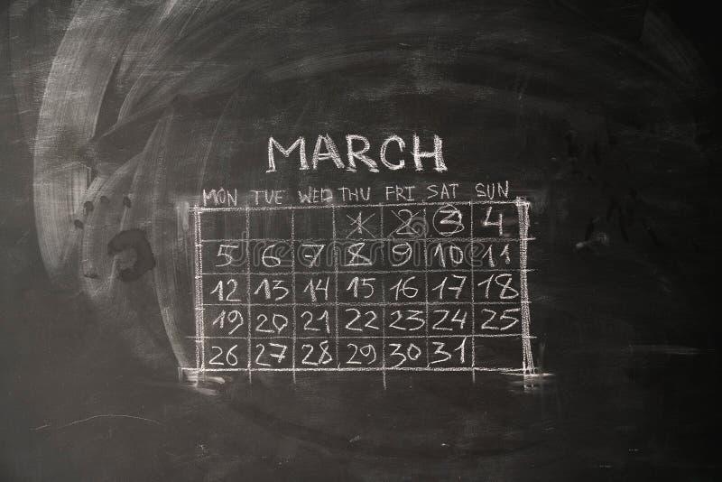 历月3月在黑板被绘 免版税库存图片
