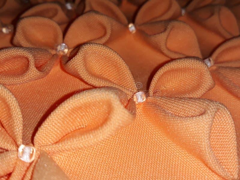 压印的橙色坐垫 图库摄影