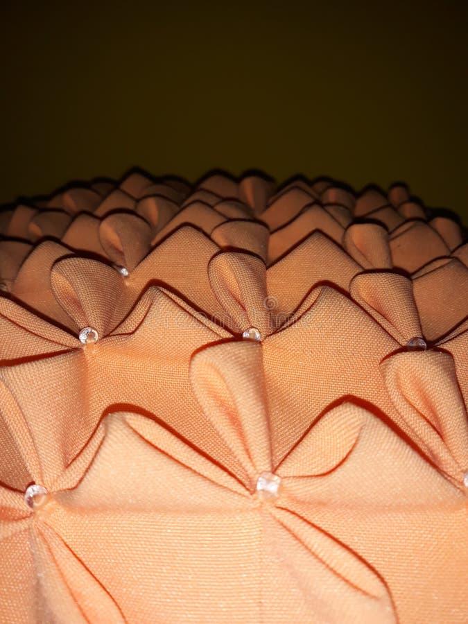 压印的橙色坐垫 库存照片