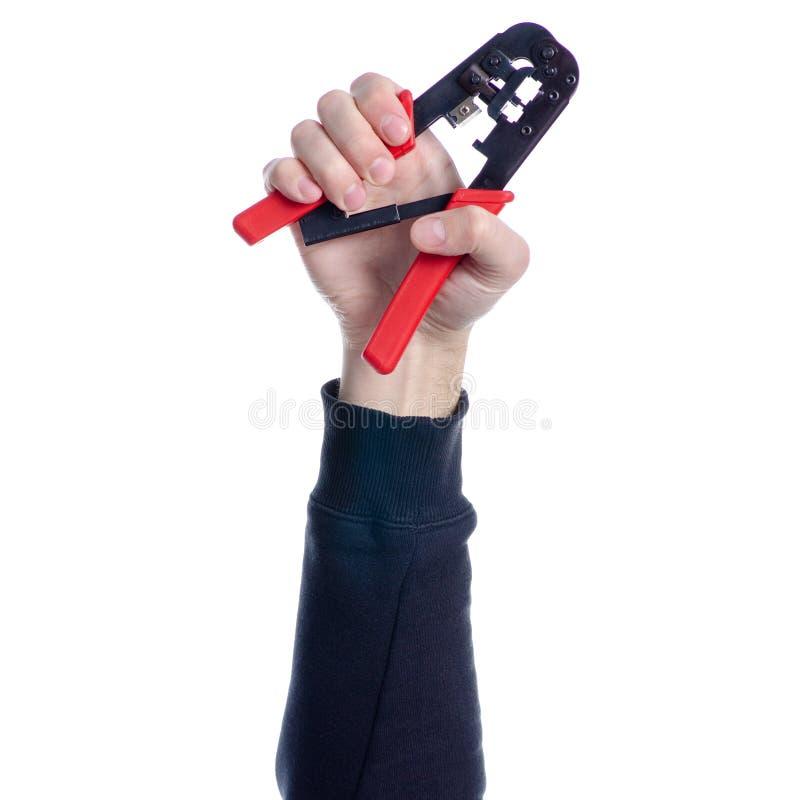 压接机在手中 免版税库存照片