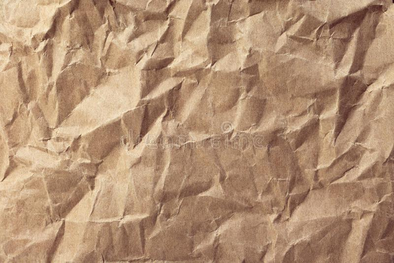 压皱纸纹理或纸板背景 被回收的纸材料表面  库存图片