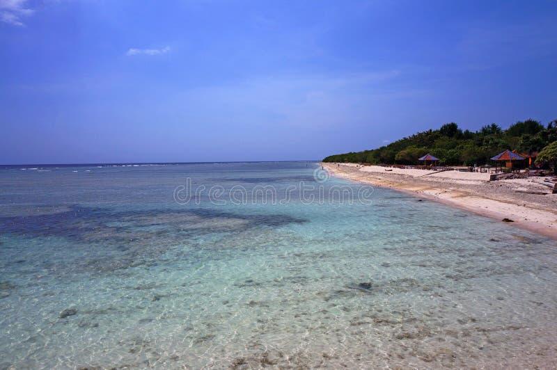 巴厘岛海原始天蓝色的水  免版税库存图片