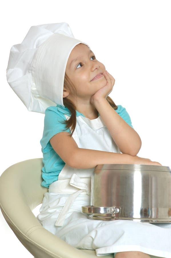厨师制服的小女孩 库存照片