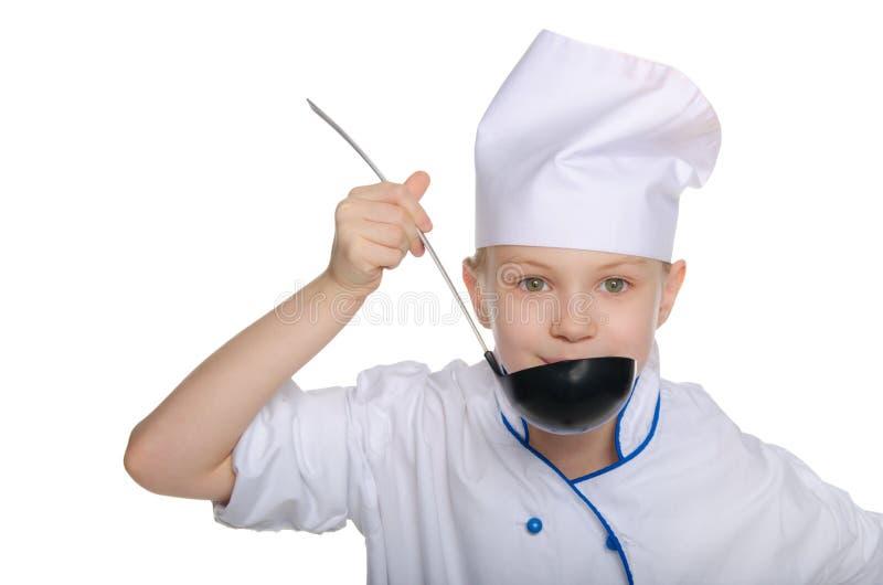 年轻厨师品尝食物 库存图片