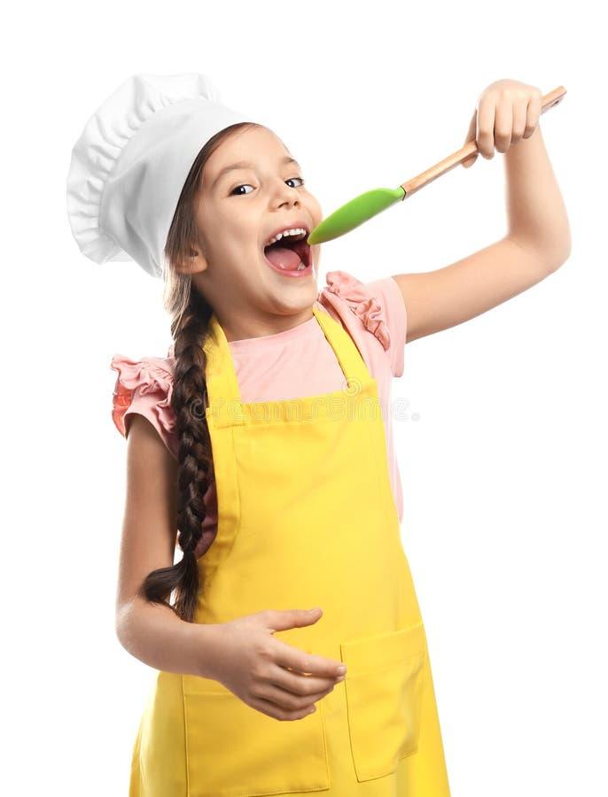 厨师帽子的逗人喜爱的女孩有小铲的,被隔绝 免版税库存照片