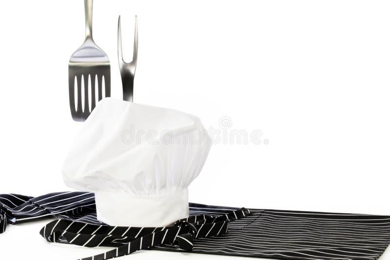 厨师帽子围裙小铲叉子 免版税图库摄影