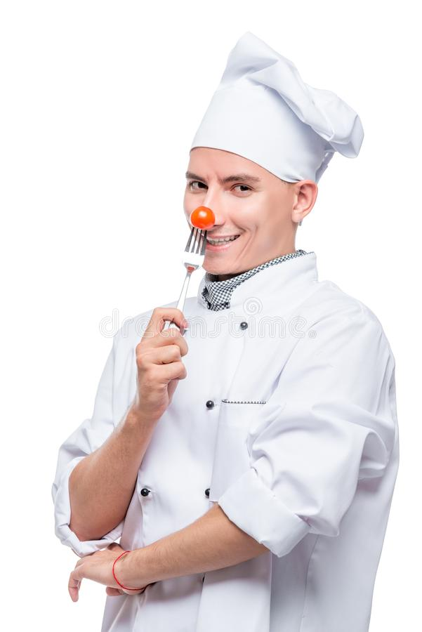 厨师用在叉子的西红柿,在白色背景的射击 免版税图库摄影