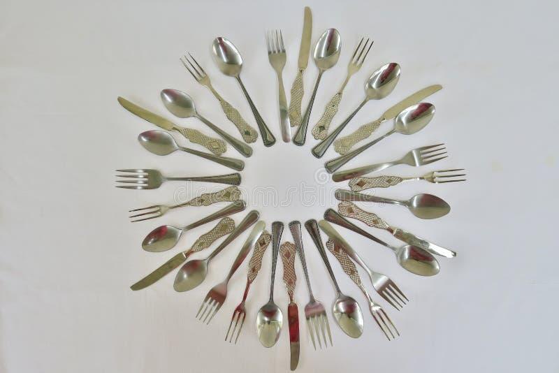 厨房套匙子叉子和刀子在白色背景 库存图片