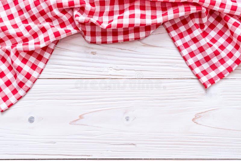 厨房布料(餐巾)在木背景 库存图片