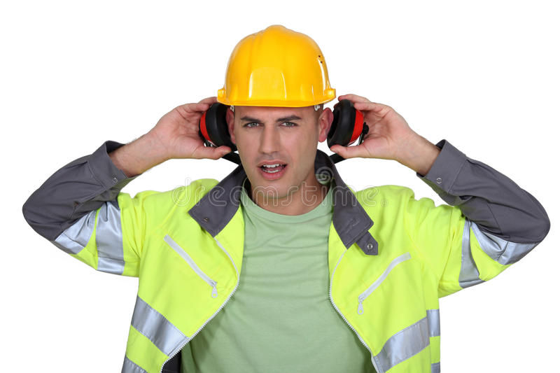 去除御寒耳罩的建造者 免版税库存照片