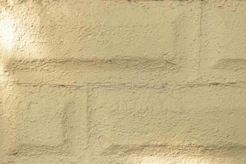 参差不齐的砖墙纹理外部棕褐色1 免版税库存图片