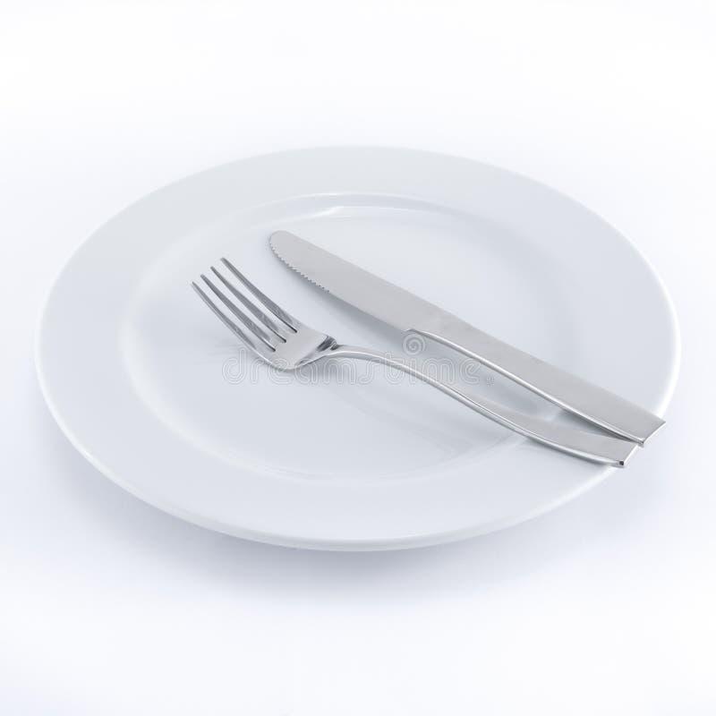 叉子刀子牌照白色 免版税库存图片