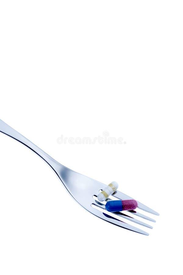 叉子医疗药片 库存照片