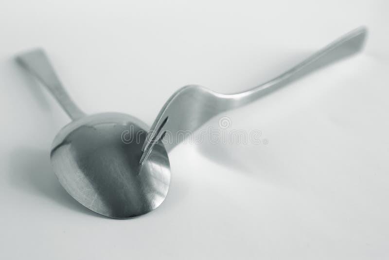 叉子和匙子有银色定调子的 免版税库存图片