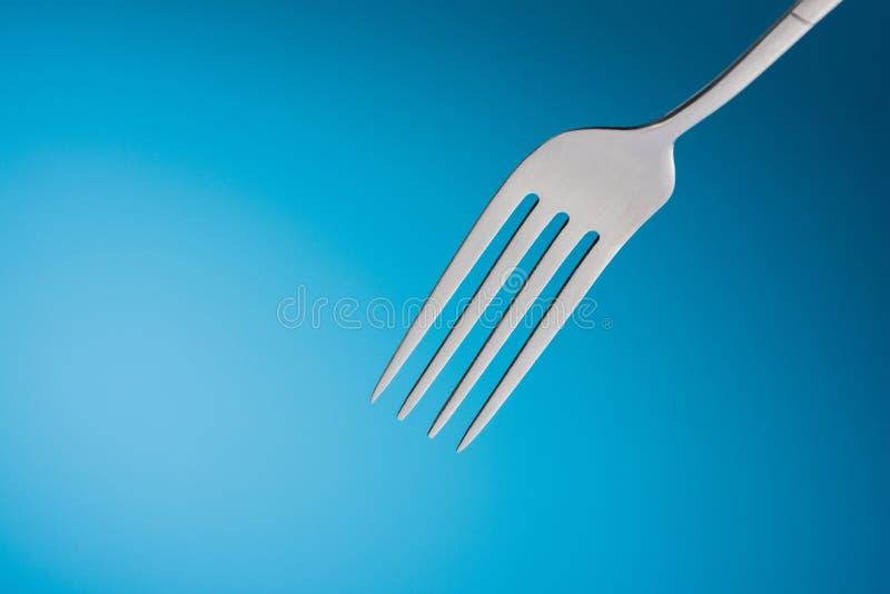 叉子在蓝色背景中 图库摄影