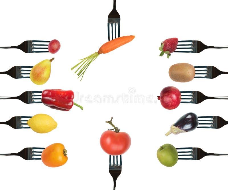 叉子背景与各种各样的蔬菜和水果的 图库摄影
