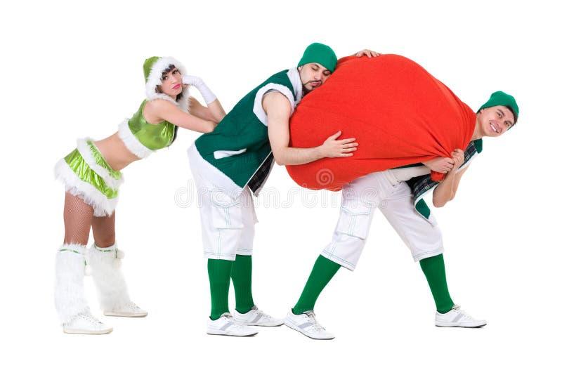 友好的人民打扮象滑稽的地精 免版税库存照片