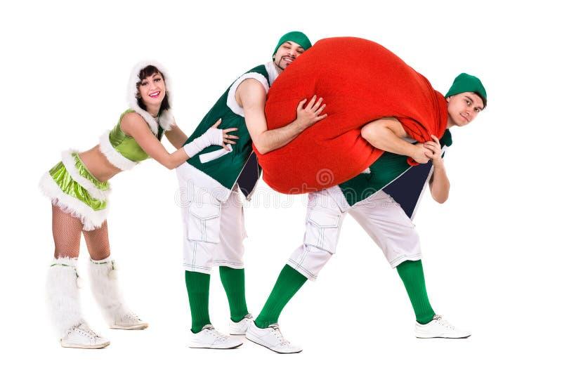 友好的人民穿戴了象滑稽的地精跳舞,隔绝在白色 免版税库存照片