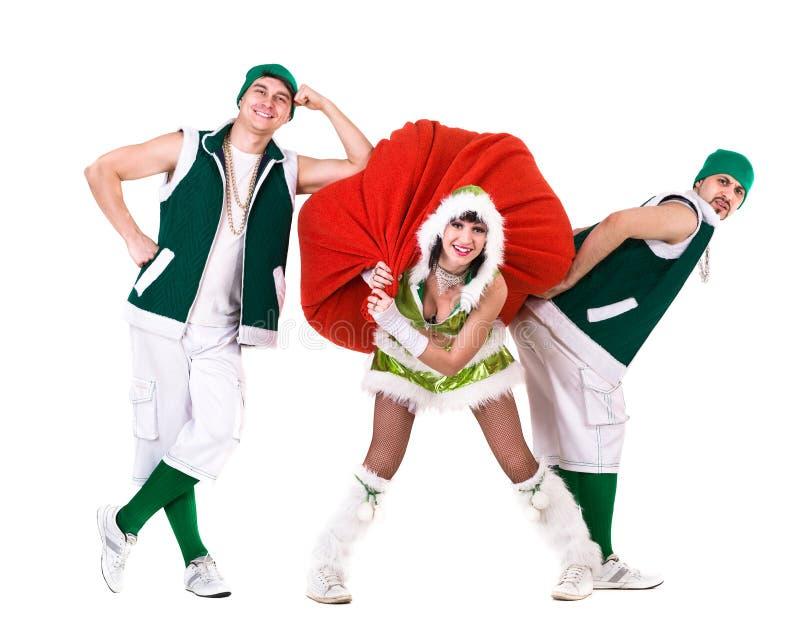 友好的人民穿戴了象滑稽的地精跳舞,隔绝在白色 免版税库存图片