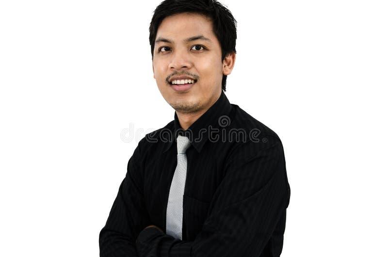 友好更加年轻的商人微笑和 免版税库存图片