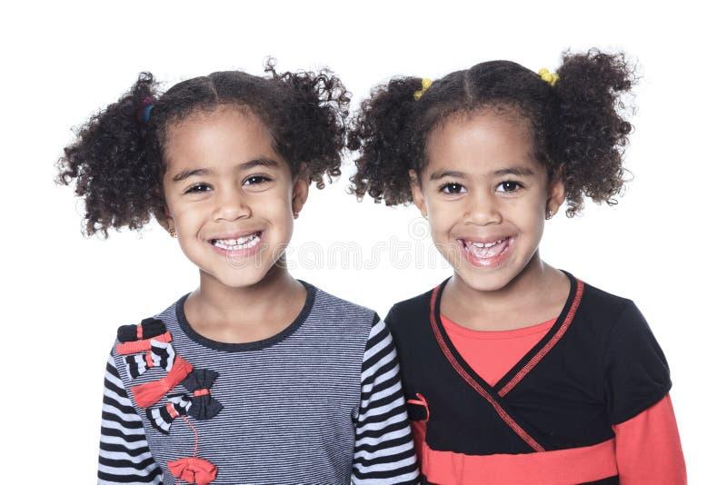 双可爱的非洲小女孩 免版税库存图片